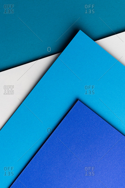 Layout of colorful cardboard sheets in blue and white shades