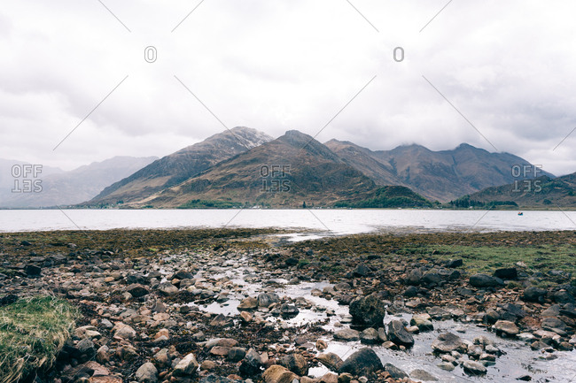 Beautiful mountain view landscape with river stream and stones