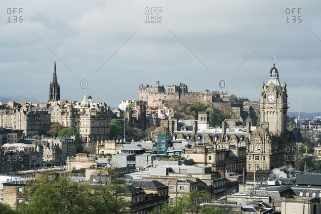 June 25, 2019: Panoramic view of old town with Gothic buildings against clouds in sunlight, Scotland