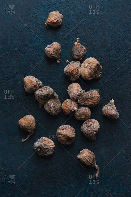 Top view image of dried mini figs on blue background