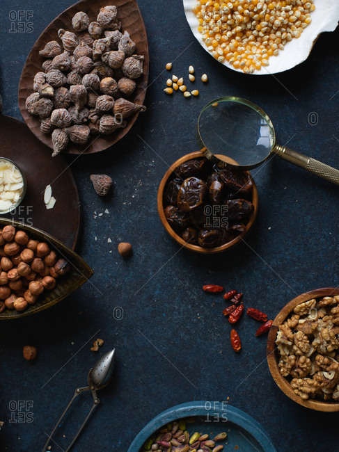 Flat lay with nuts and dried fruits: hazelnuts, walnuts, raisins