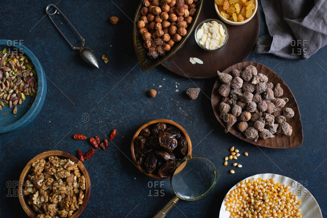 Top view of various nuts and dried fruits: hazelnuts, walnuts, raisins
