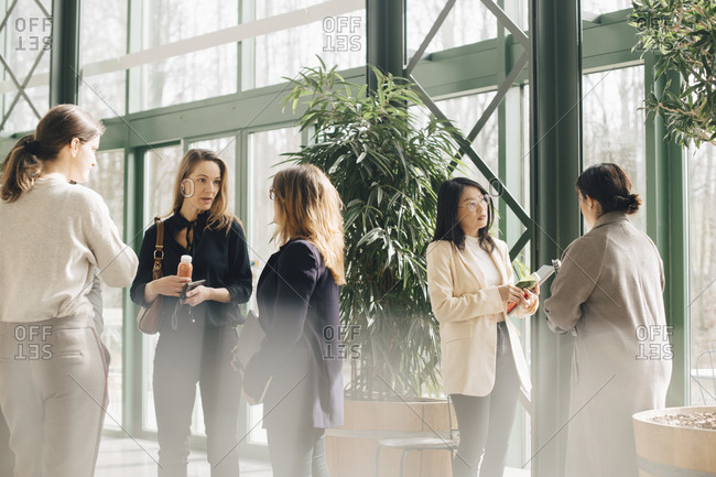 Multi-ethnic businesswomen networking in conference event
