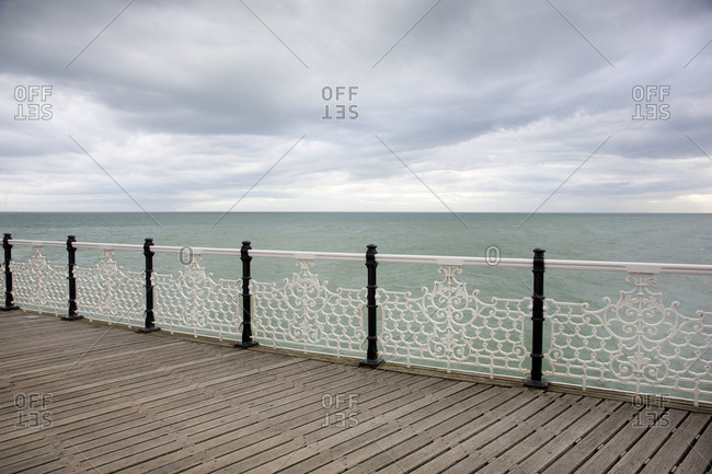 Decorative pier railings on overcast day, Brighton, England