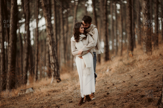 Couple embraced in a forest