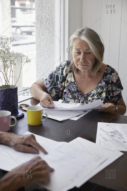 Senior woman doing paperwork
