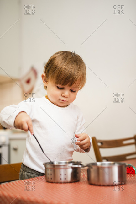 Boy playing with pots