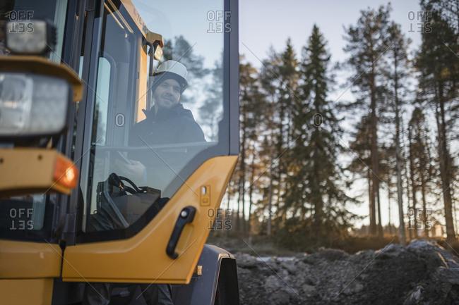 Man entering digger - Offset Collection