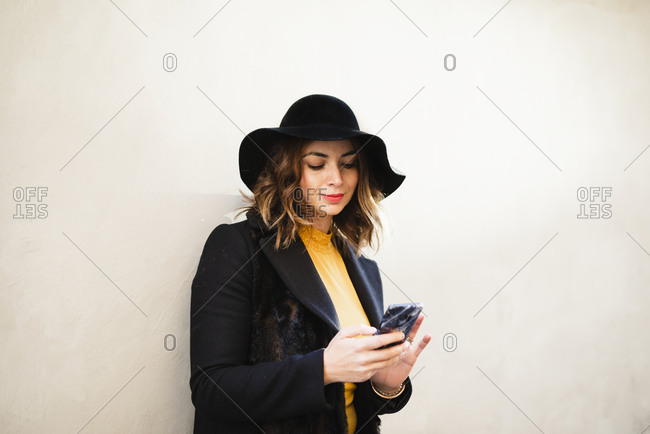 Smiling woman using phone
