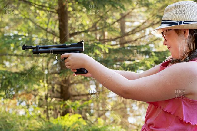 Girl aiming gun - Offset Collection