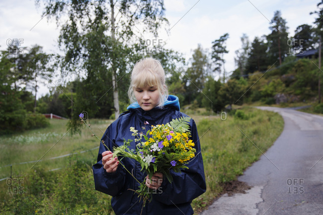 Teenage girl holding wildflowers