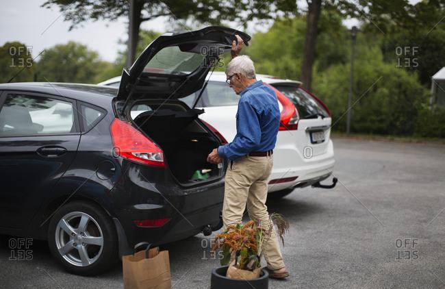 Senior man packing car