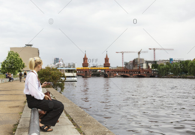 Woman sitting at river