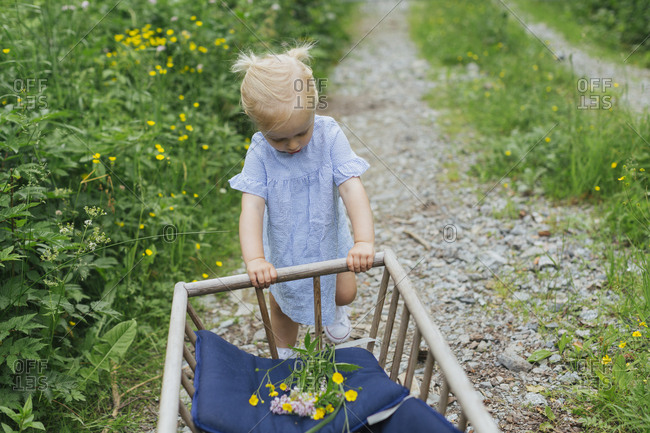 Girl with wooden cart