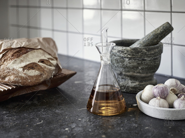 Oil, garlic and bread on worktop