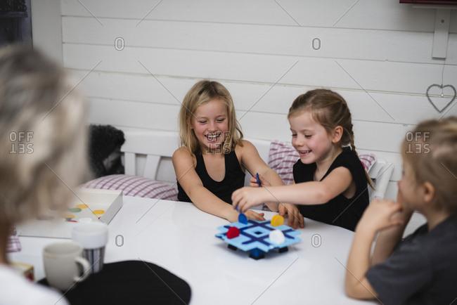 Girl playing board game