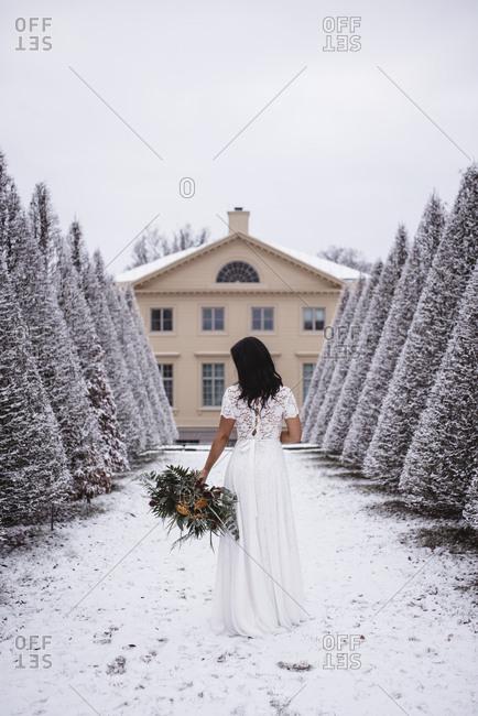 Bride in winter garden