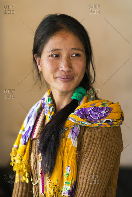 A pretty Nepali girl from a small village smiling and looking away