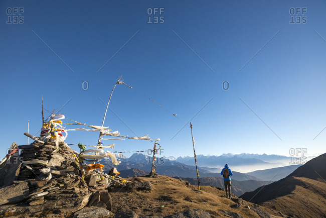 Pikey, Solukhumbu, Nepal - December 13, 2015: Man standing on the top of Pikey Peak in the Nepal Himalayas with Everest in background