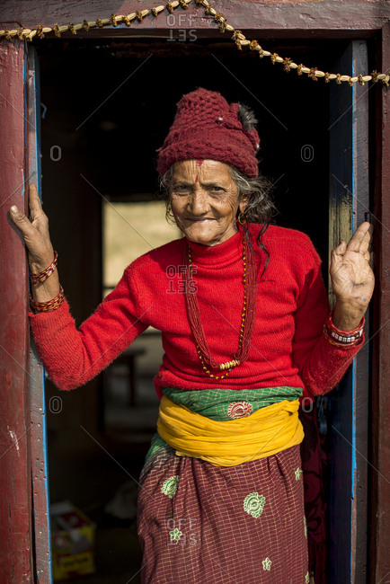 Nepal - December 8, 2015: An Nepali woman standing in a doorway in a small village in Nepal