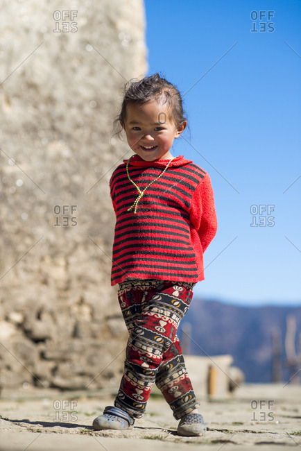 Ngaur, Solukhumbu, Nepal - December 13, 2015: A little Nepali girl in Solukhumbu district of Nepal smiles for the camera
