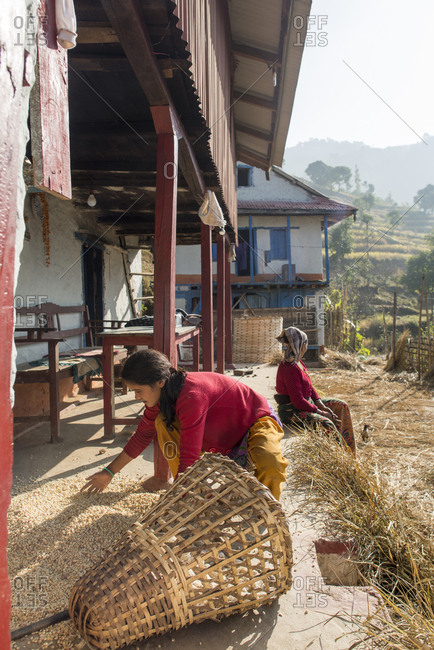 Diktel, Khotang District, Nepal - December 9, 2015: Women working at a traditional village house near Diktel in Nepal