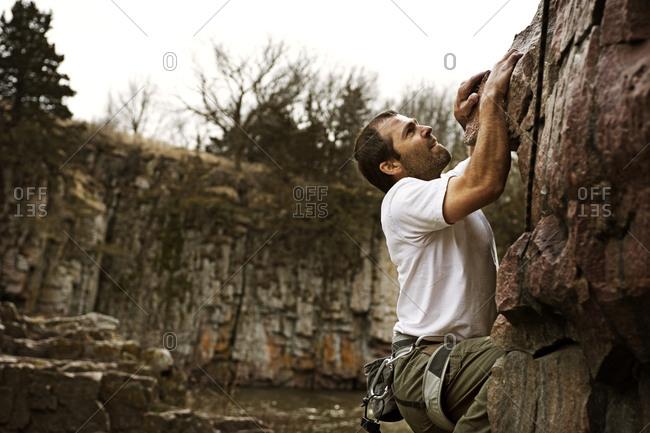A man sport climbs at Palisades State Park, South Dakota.