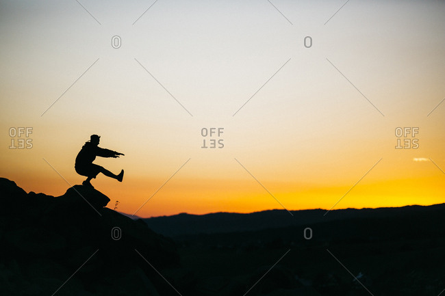 Silhouette Of Person Doing One Legged Squats