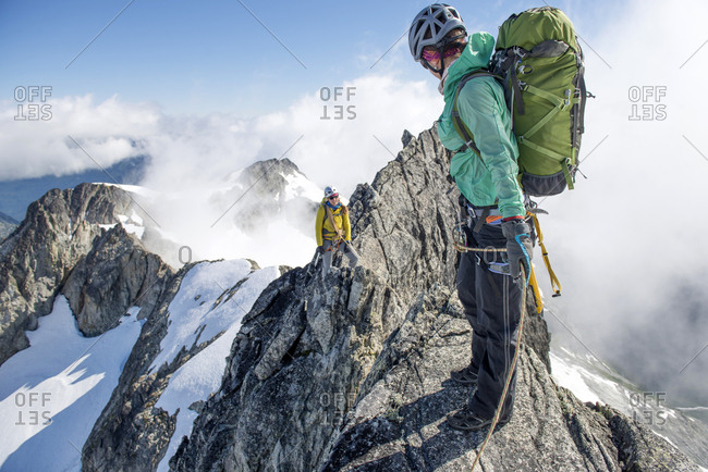 Two woman climbing on the North Ridge of Forbidden Peak in North Cascades National Park.
