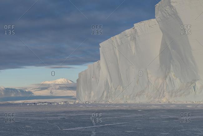 An iceberg frozen into the sea ice of the Ross Sea, Antarctica.