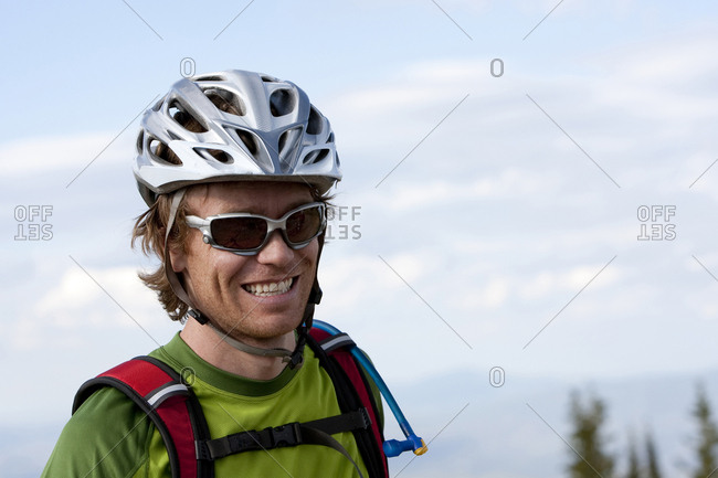 A man is all smiles during a bike ride on the Crest trail in the Wasatch mountains.