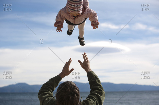 A father and daughter enjoy the outdoors at Commons Beach in Tahoe City, California.