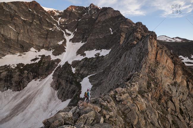 A climber approaches the Four Aces on Ypsilon Mountain, Rocky Mountain National Park, Colorado.