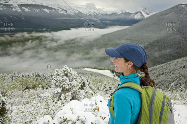 A woman looks out over Kananaskis Country, Alberta, Canada.
