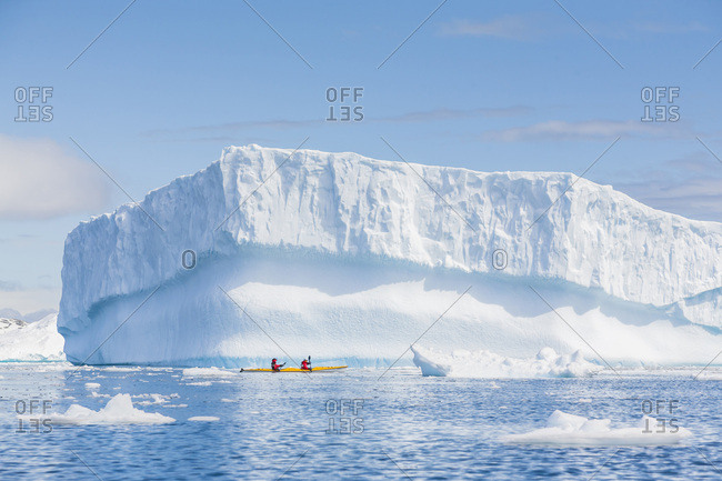 Paddlers in a double sea kayak, Cierva Cove, Antarctic Peninsula, Antarctica.