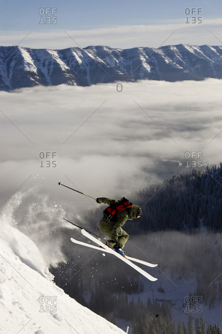 Young woman catches air at Fernie Alpine Resort, BC, Canada