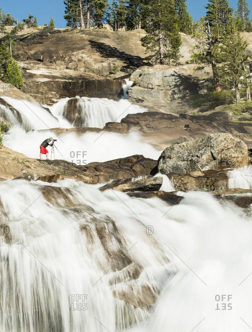 Phographer photographing Waterwheel falls, Grand Canyon of the Tuolumne, Yosemite National Park