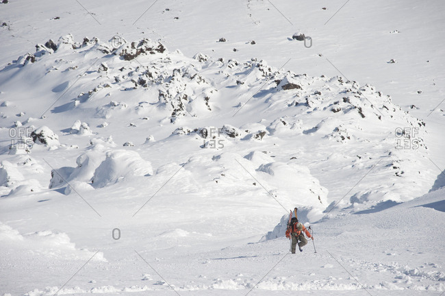 Male skier ascends the Northeast flanks of  Mt Augustine