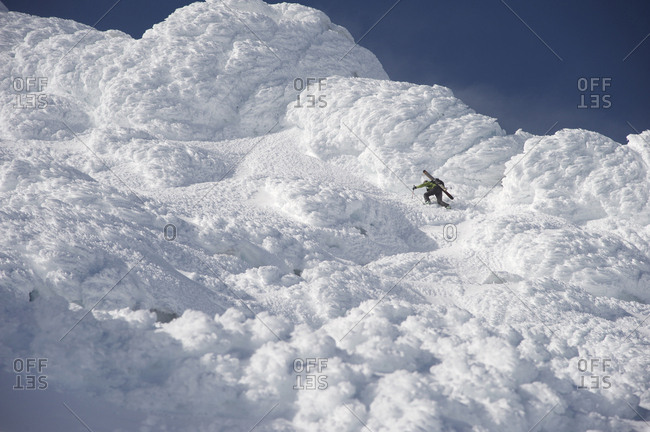 Woman skier climbs through thick rime ice on the Northeast flanks of  Mt Augustine