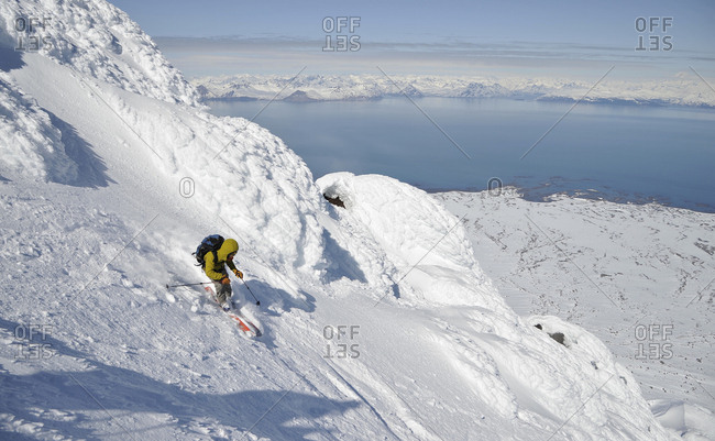 Skiers descend from the summit of  Mt Augustine