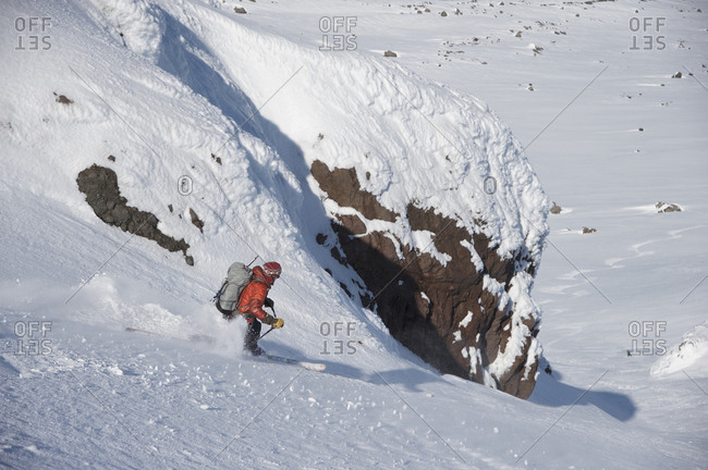 Skiers descend from the summit of  Mt Augustine, a 4,025-foot high active volcano on Augustine Island in Cook Inlet, Alaska