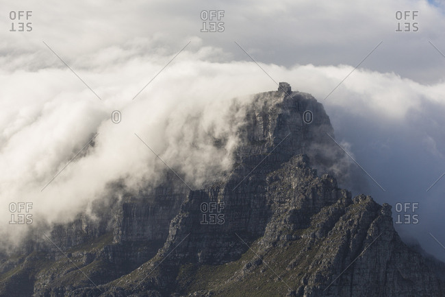 Clouds wrap around Table Mountain in Cape Town, South Africa
