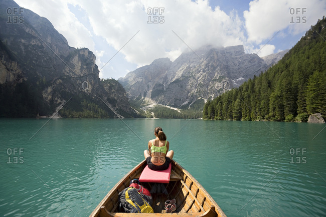 Woman relaxing in a row boat in the Italian Dolomites
