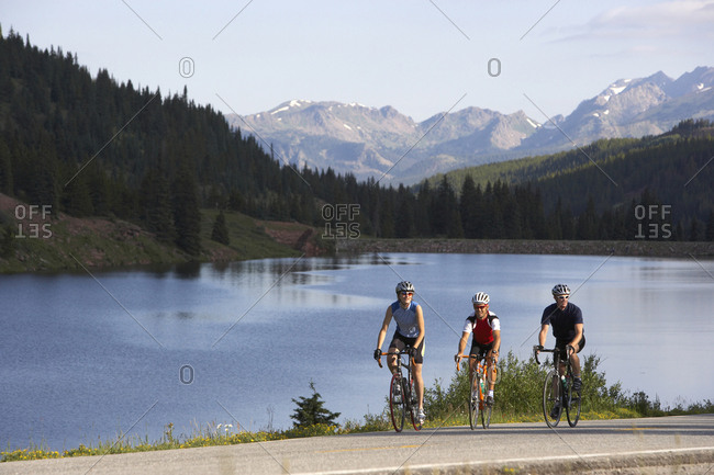 Cyclists riding at the crest of a mountain pass near Vail, Colorado.