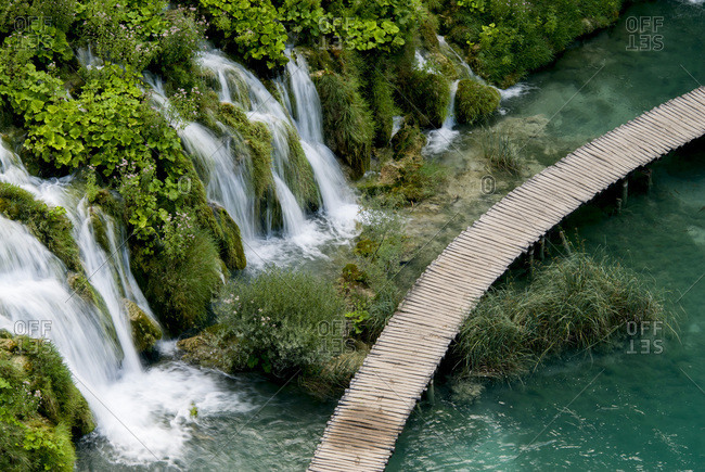 High Angle View Of Waterfall And Boardwalk At Plitvice Lakes National Park