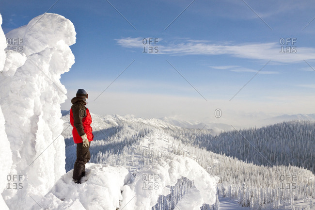 Male Snowboarder Standing On Top Of A Snow Shaped Ghost At Whitefish, Montana, USA