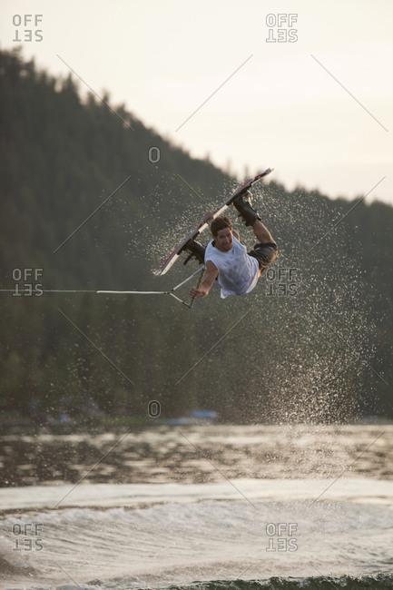 Male wakeboarding in Idaho.