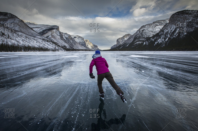 Ice skating at Lake Minnewanka, Banff National Park, Alberta, Canada