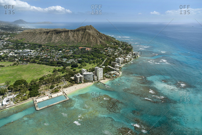 Helicopter overview of Natatorium, Hotel and Diamond Head in Honolulu