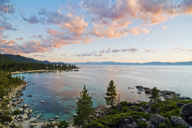 Beautiful clouds are illuminated at sunset over Sand Harbor and Lake Tahoe, Nevada.